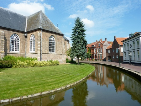 flakkee: The church with the moat in Dirksland in the Netherlands Stock Photo