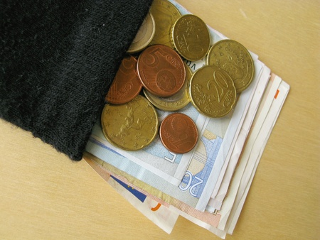 Euro coins and banknotes in an old stocking photo