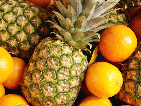 Pineapples and oranges at the greengrocer photo