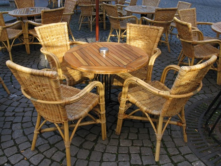round chairs: An empty table with four chairs of a terrace