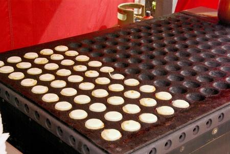Poffertjes are a traditional Dutch batter treat, photo