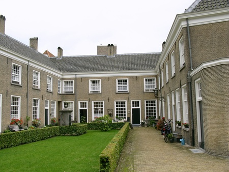 breda: The Beguinage in Breda in the Netherlands a coutyard with small houses and a herb garden Stock Photo
