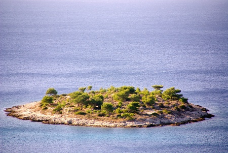 One of the small island in the Adriatic sea of Croatia photo