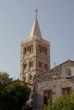 One of the church towers of Rab town on the island Rab in Croatia photo