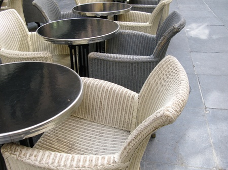 Tables and chairs on a terrace photo