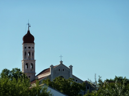 The campanile of the church of Betina at the island Murter in Croatia photo