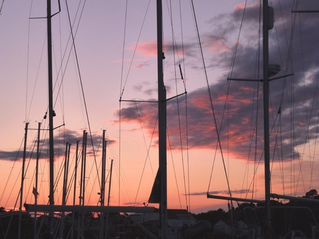 betina: Colourful sunset with a marina in front in the Mediterranean