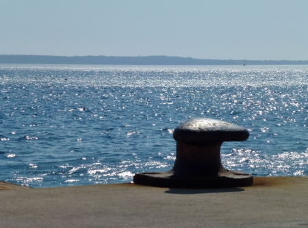 cleat: A mooring bollard at the quay of a harbor Stock Photo