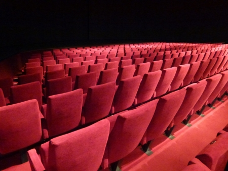 Rows with red chairs in a theatre Stock Photo