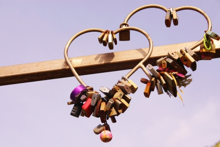 locks: Locks with the keys thrown away in the sea the symbol of love for ever in Cinque terre in Italy