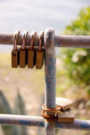 Locks with the keys thrown away in the sea the symbol of love for ever in Cinque terre in Italy photo