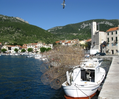 stackable: Piled fish traps on a small fishing boat in the harbor of Komiza on the island Vis in Croatia