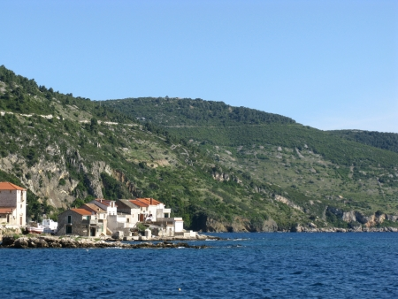 Komiza a city on the island Vis in Croatia in the Adriatic sea photo