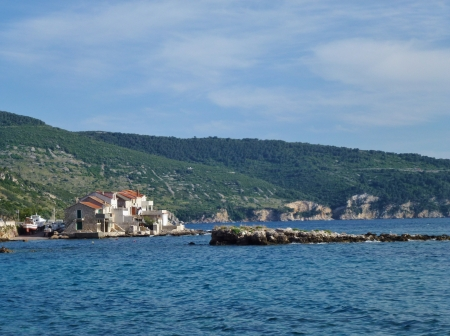 overlook: Komiza a city on the island Vis in Croatia in the Adriatic sea  Stock Photo