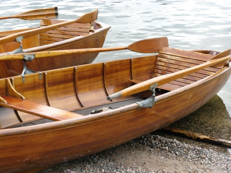 Wooden ancient rowing boats photo