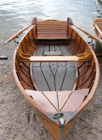 Wooden ancient rowing boat photo