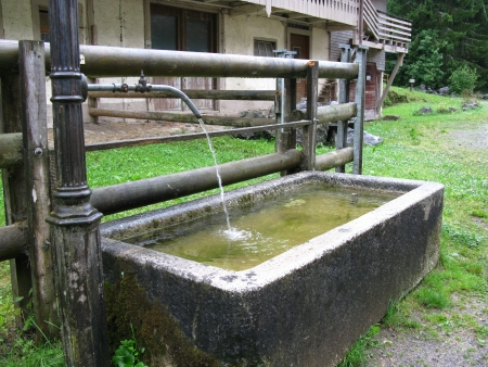 trough: A watering through at a farm Stock Photo