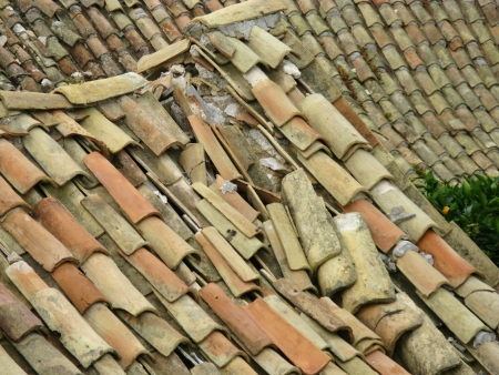 The ruin of a roof with ceramic tiles  in Lastovo town on the island Lastovo in Croatia photo