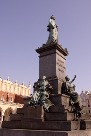 The statue of Adam Mickiewicz in front of the cloth hall in Krakow in Poland Stock Photo - 14960293