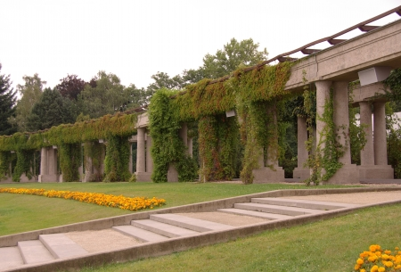 Pergola in the shape of half of a ellipse  on the exhibition grounds of the Centennial Hall