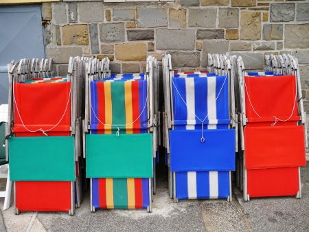 stackable: Colorful stored deckchairs Stock Photo