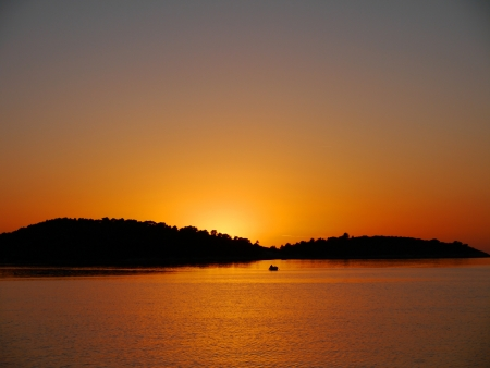 Sunset near the island Kaprije in the Adriatic sea of Croatia photo