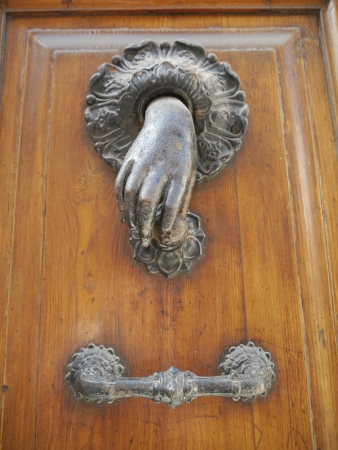 A hand of bronze as a doorknocker Stock Photo - 16001918