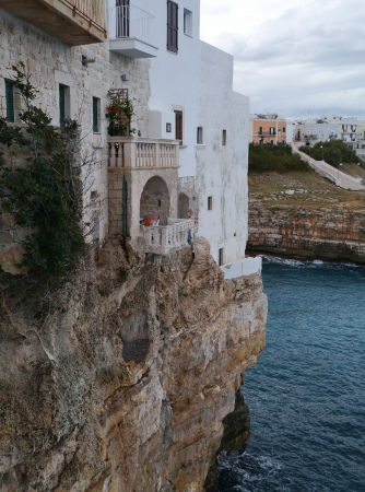 fronts: Houses on the rocks of the coast of Polignano a mare at the Mediterranean in Italy