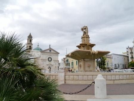 twentieth: The Maddalena church and the monumental fountain on the twentieth September square in Mola di Bari in Apulia in Italy  Stock Photo