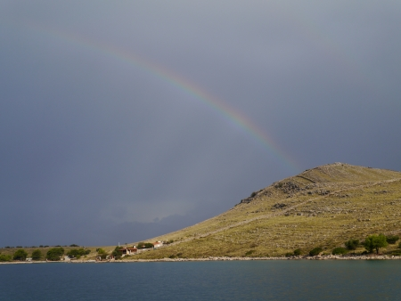kornati national park: A rainbow above  one of the islands in the Kornati national park in Croatia