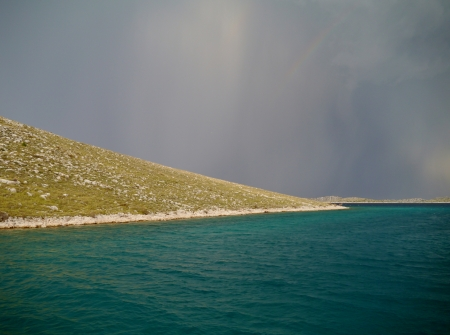 seasonally: The green water of the Adriatic sea during a thunderstorm Stock Photo