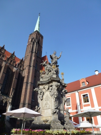 The church of the holy cross with the sculpture of John of Nepomuk in Wroclaw in Poland photo