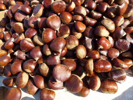 market place: Brown chestnuts on a market place