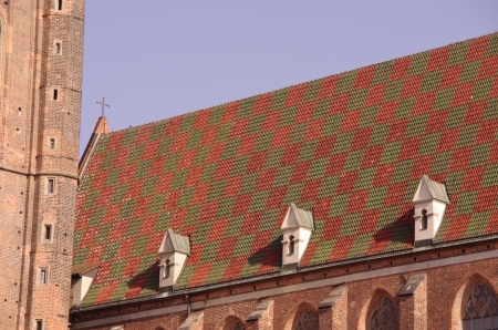 The saint Elizabeth church with the colorful roof in Wroclaw in Poland photo