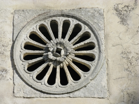 The rosette of a church in Monte Saint Angelo in Italy Stock Photo - 16572339