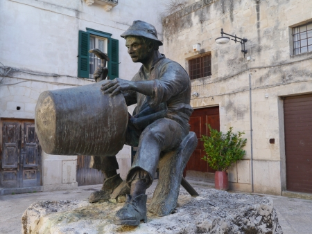 sassi: A statue of a tinker on a square in Matera inItaly