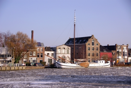 Classic sailing boat in winter in the harbor of Delft in the Netherlands Stock Photo - 16658127