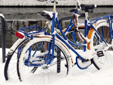Bicycles covered with snow in the winter photo