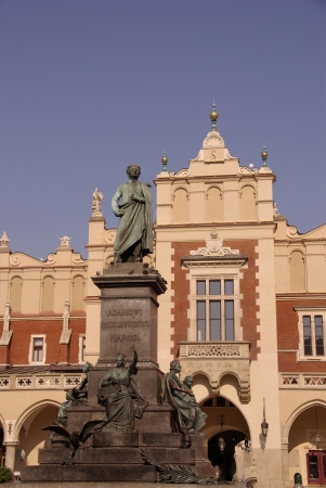 The statue of Adam Mickiewicz in front of the cloth hall in Krakow in Poland