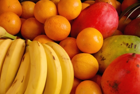 Bananas, oranges and mangoes at the greengrocer on the market place Stock Photo - 16752904