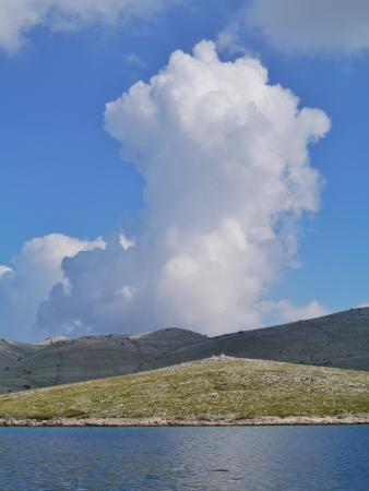 kornat: The island Kornat with a cumulus cloud in the Kornati national park in Croatia Stock Photo
