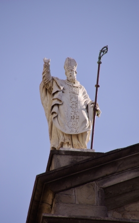 A statue on the roof of the Saint Zeno cathedral in Pistoia in Tuscany in Italy photo