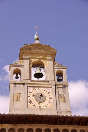 The bell tower of the gothic palace of the lay fraternity in Arezzo in Tuscany in Italy photo