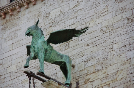 Animals on the city hall in Perugia in Tuscany in  Italy photo