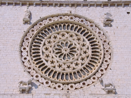 A rose window of the basilica of san Francesco  saint Francis  in Assisi in Tuscany in Italy photo