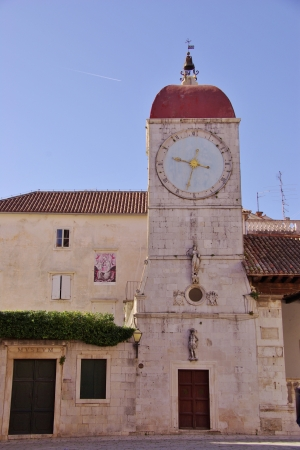 The historic bell tower in Trogir in Croatia photo