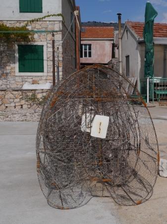 kornat: Piled fish traps ashore in a fishermen village in Croatia Stock Photo