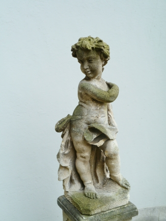 A sculpture of a young child in a garden Stock Photo - 17236468
