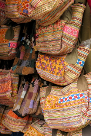 folkloristic: Handicraft colorful bags on a market in Sapa in Vietnam