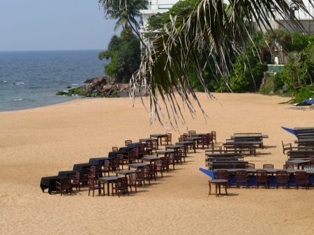 Tables and chairs on the beach in Mount Lavinia in Sri Lanka photo